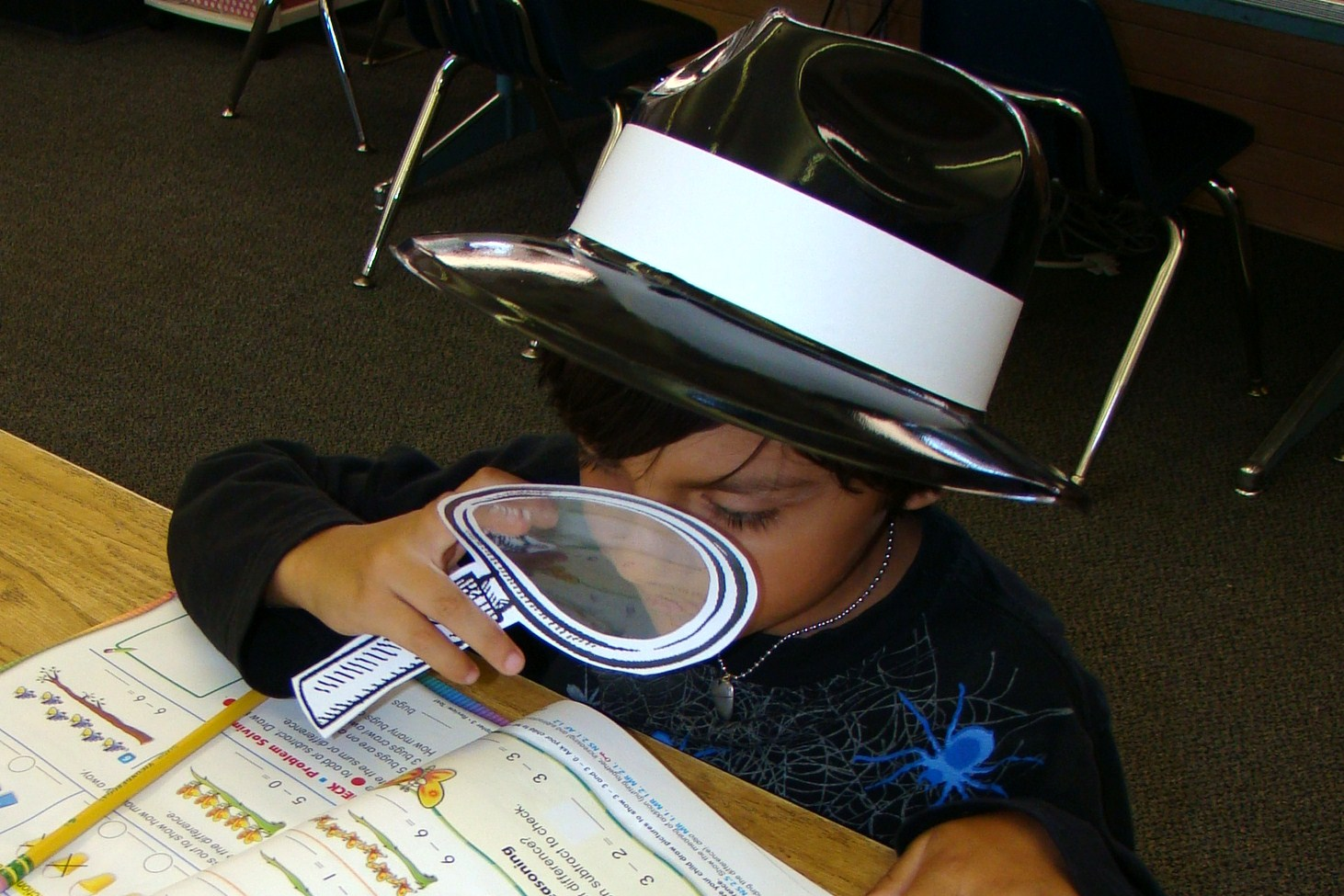 Math Detectives_looking for clue words and numbers to help solve the problem.JPG